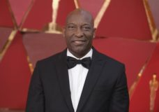 """FILE - This March 4, 2018 file photo shows John Singleton at the Oscars in Los Angeles. The family for Singleton says the filmmaker will be taken off life support Monday, April 29, 2019, after suffering a stroke almost two weeks ago. In a statement Monday, Singleton's family said it was """"an agonizing decision, one that our family made over a number of days with the careful counsel of John's doctors."""" (Photo by Richard Shotwell/Invision/AP, File)"""
