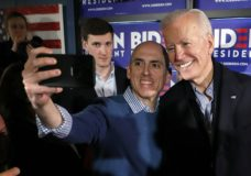 Former vice president and Democratic presidential candidate Joe Biden takes a selfie with a supporter during a campaign stop at the Community Oven restaurant in Hampton, N.H., Monday, May 13, 2019. (AP Photo/Michael Dwyer)