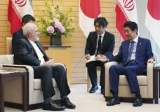 "Iranian Foreign Minister Mohammad Javad Zarif, left, and Japanese Prime Minister Shinzo Abe, right, speak at Abe's official residence in Tokyo Thursday, May 16, 2019. Iran's foreign minister has said his country is committed to an international nuclear deal and criticized escalating U.S. sanctions ""unacceptable"" as he met with Japanese officials in Tokyo amid rising tensions in the Middle East.(AP Photo/Eugene Hoshiko, Pool)"
