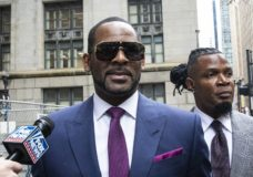 FILE - This March 13, 2019 file photo shows R. Kelly and his publicist Darryll Johnson, right, leaving The Daley Center after an appearance in court for Kelly's child support case in Chicago. Prosecutors in Chicago have charged Kelly with 11 new sex assault charges, some that are more serious than those first filed against him in February. The Chicago Sun-Times reported Thursday, May 30, on its website that the charges include counts that carry a potential sentence of up to 30 years in prison. The charges say the alleged offenses happened in 2010. (Ashlee Rezin/Chicago Sun-Times via AP, File)