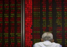 A Chinese investor monitors stock prices at a brokerage house in Beijing, Friday, May 31, 2019. Asian shares were mixed Friday as trade worries continued after President Donald Trump announced additional tariffs on imports from Mexico. (AP Photo/Mark Schiefelbein)