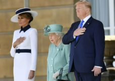 US President Donald Trump and first lady Melania Trump attend a welcome ceremony with Britain's Queen Elizabeth II in the garden of Buckingham Palace, in London, for Monday June 3, 2019, on the first day of a three day state visit to Britain. (Toby Melville/Pool via AP)