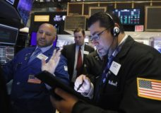 FILE- In this June 6, 2019, file photo specialist John Parisi, left, works with traders on the floor of the New York Stock Exchange. The U.S. stock market opens at 9:30 a.m. EDT on Thursday, June 13. (AP Photo/Richard Drew, File)