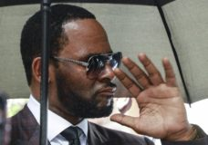 "FILE - In this June 26, 2019, file photo, Musician R. Kelly departs from the Leighton Criminal Court building after a status hearing in his criminal sexual abuse trial in Chicago. elly was charged with racketeering and sex-related crimes against women and girls in sweeping New York federal indictment unsealed Friday, July 12. The 18-page indictment accuses Kelly and members of his entourage of recruiting women and girls to ""engage in illegal sexual activity with the singer. (AP Photo/Amr Alfiky, File)"