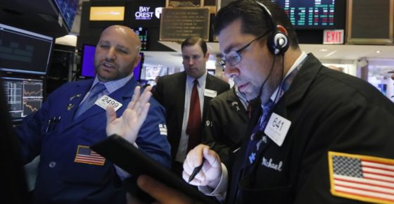 FILE - In this June 6, 2019, file photo specialist John Parisi, left, works with traders on the floor of the New York Stock Exchange. The U.S. stock market opens at 9:30 a.m. EDT on Friday, July 12. (AP Photo/Richard Drew, File)